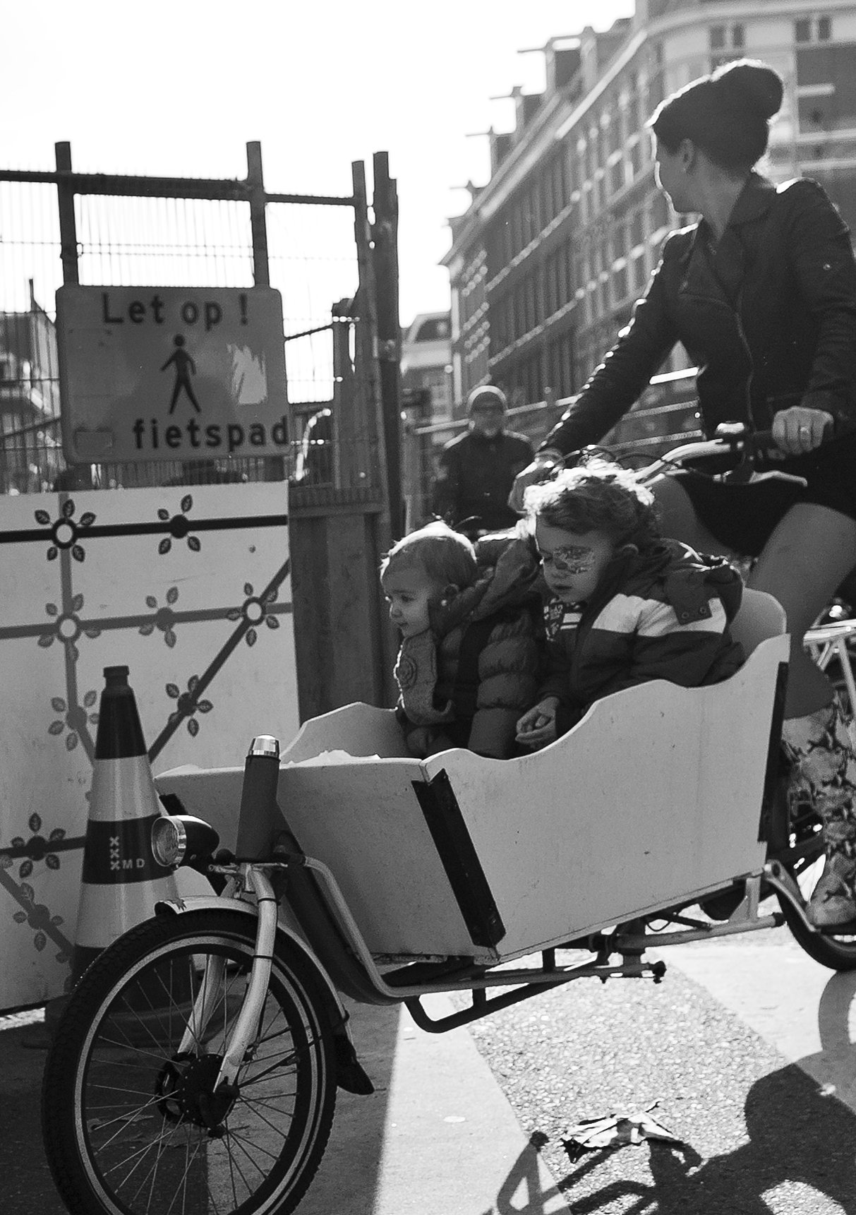 Amsterdam - woman with children in the morning